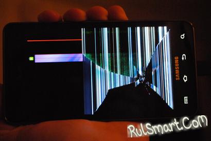 на экране планшета треугольник с восклицательным знаком